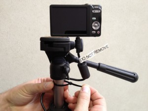 Scure your digital passport camera USB cable to the tripod