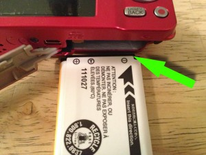 Match up the 3 icons on the Fuji battery for proper alignment